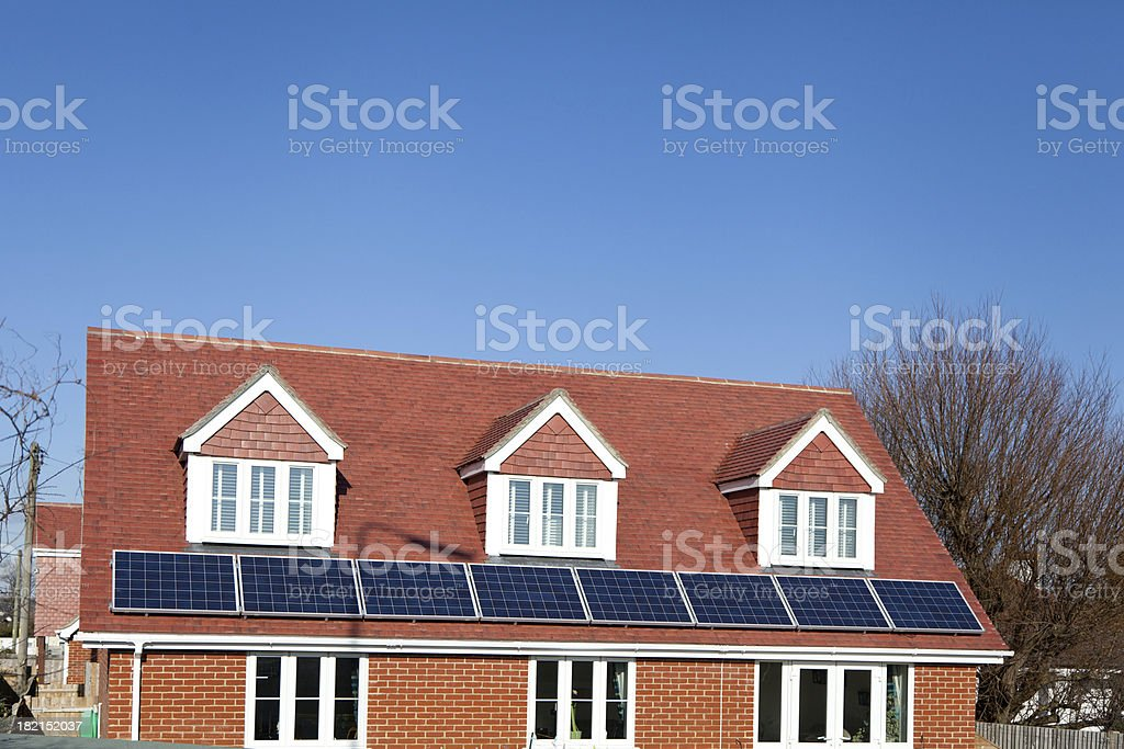 New roof with solar panels stock photo