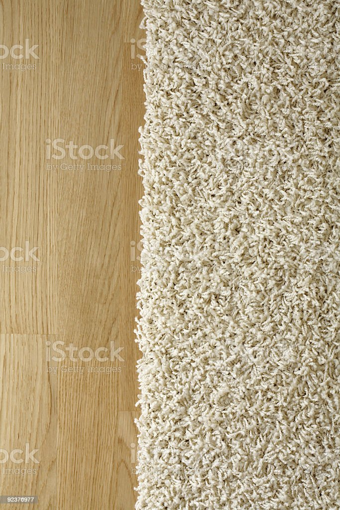 New rug next to a hard wood floor royalty-free stock photo