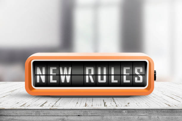 New rules alarm message on a wooden desk stock photo