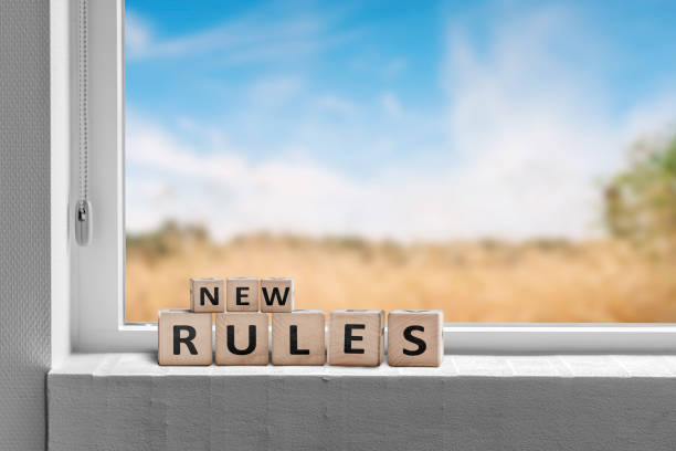 New rules sign in a window with a view to fields stock photo