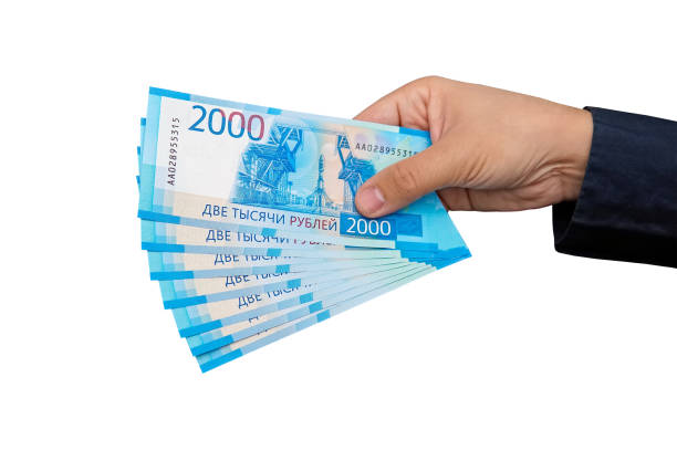new Russian banknotes denominated in 2000 rubles in male hands stock photo