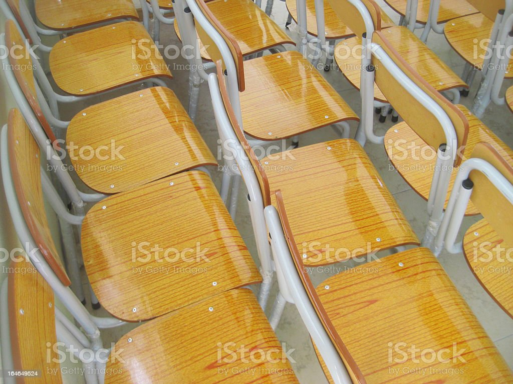 new school chairs of faux wood in group royalty-free stock photo