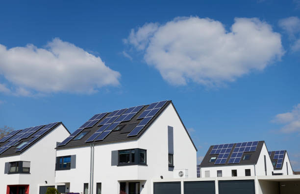 New settlement / Contemporary white one-family houses with solar panels stock photo