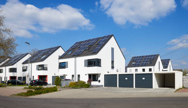 New settlement / white twin-houses with solar panals and garages stock photo