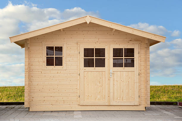 new shed isolated with clippping path front view of a new shed isolated with clippping path shed stock pictures, royalty-free photos & images