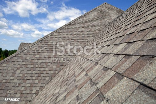 istock New Shingled Roof with Blue Sky Background 183780507