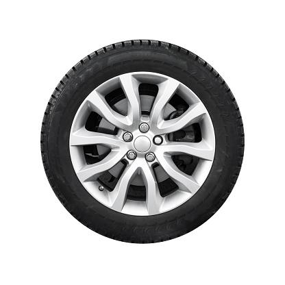 New shiny automotive wheel on light alloy disc isolated on white background