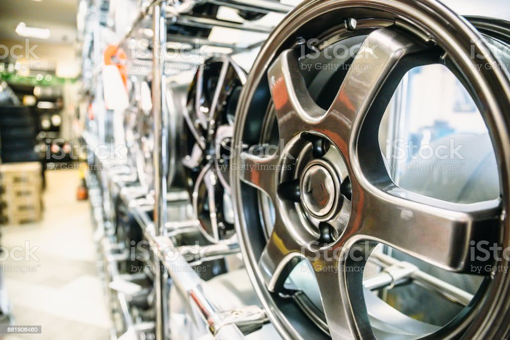 New shiny Car wheels in market or shop in auto service stock photo