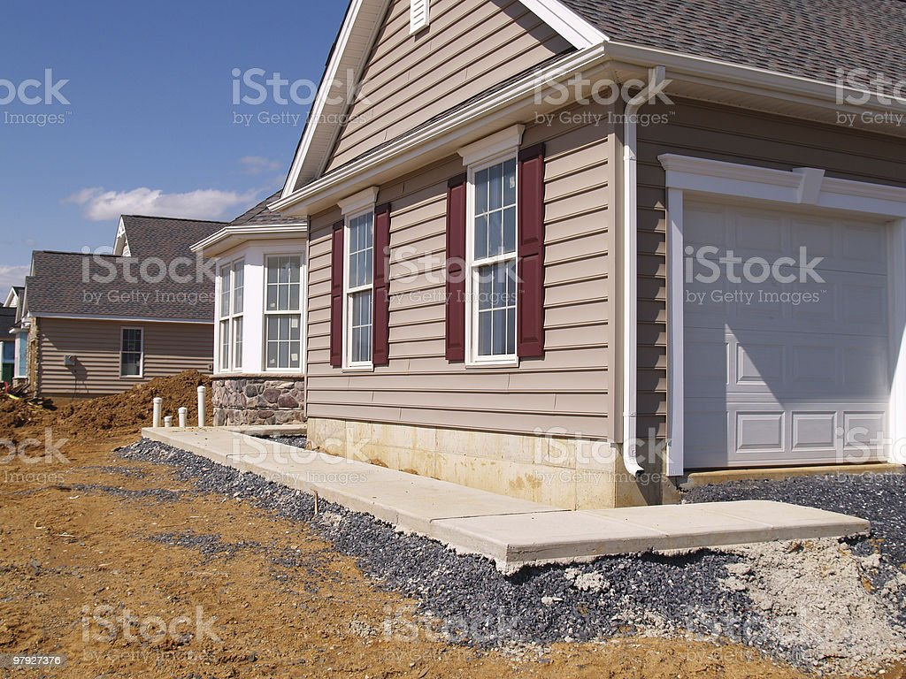 new sidewalk by a home construction royalty-free stock photo