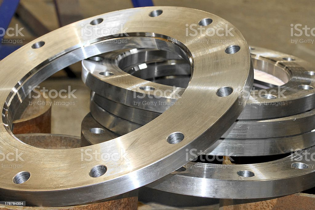 New silver flanges in workshop royalty-free stock photo