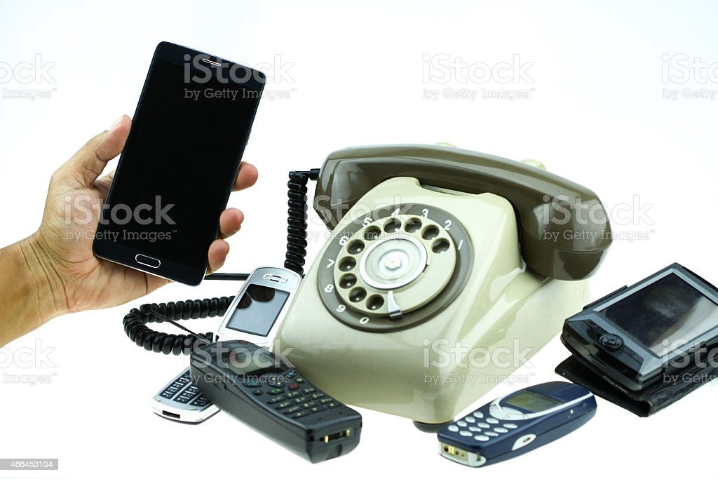 New smart phone with old telephone on white background. stock photo