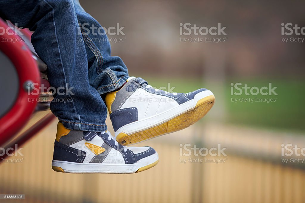 New sneakers on boys feet stock photo