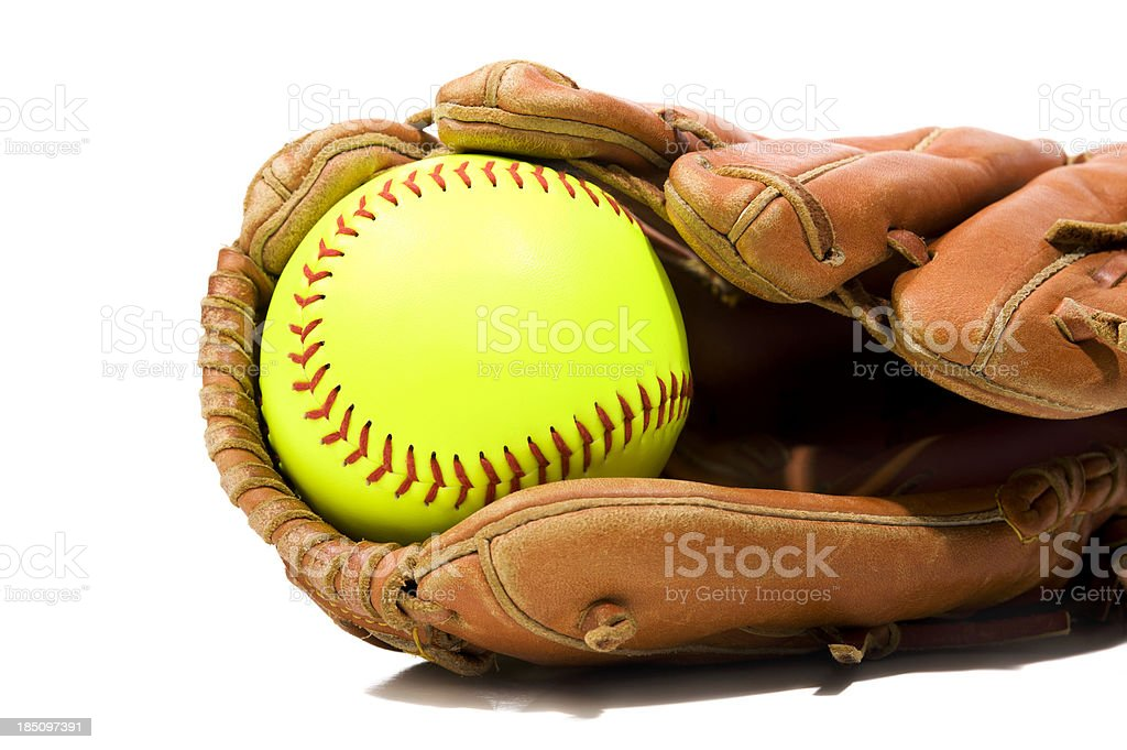 New Softball in a glove on white background royalty-free stock photo