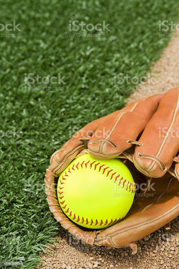 New Softball in glove stock photo