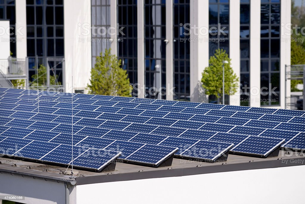 New solar panels on the roof of an industrial building stock photo