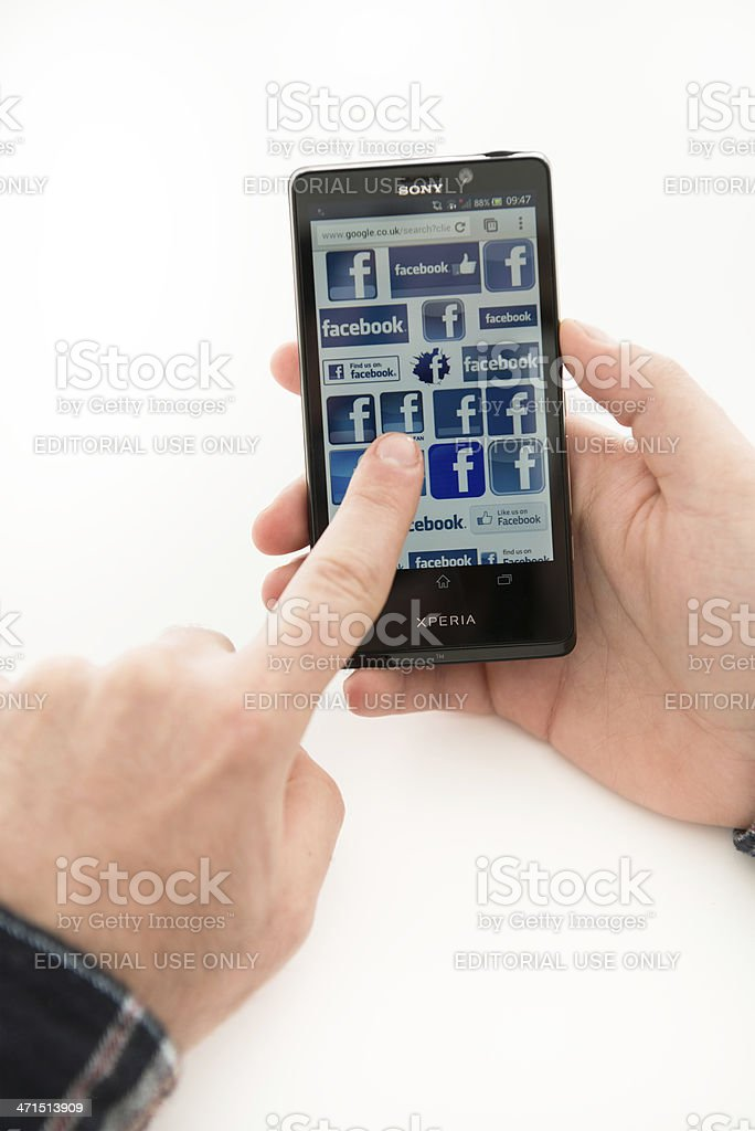 new Sony xperia T with Facebook icons on the screen royalty-free stock photo