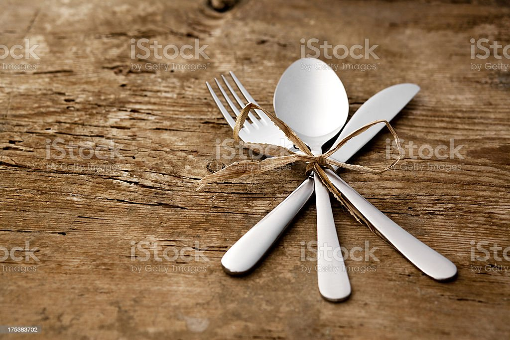 New spoon, table knife and fork stock photo