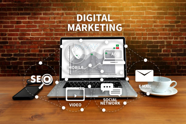 digital marketing new startup project millennials business team hands at work with financial reports and a laptop - digital marketing stock pictures, royalty-free photos & images