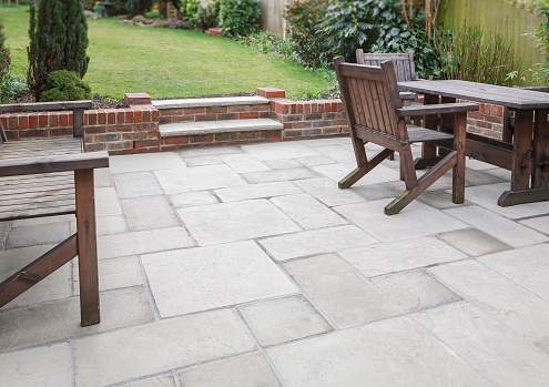 New flagstone patio and backyard, outdoor garden patio with furniture, UK