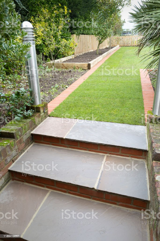 New Stone Steps And Turf Laid During A Winter Garden Landscaping Project Along With New Brick Edging And A New Bed Edged With Railway Sleepers Stock Photo Download Image Now Istock