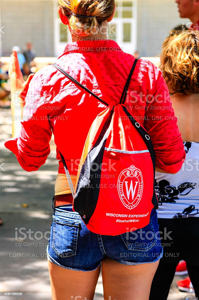 New students wearing backpacks of the University of Wisconsin stock photo