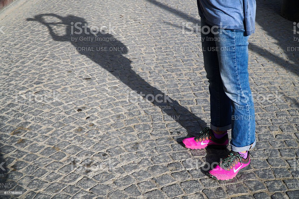 New Style Pink Nike Shoes at Street with Photographers Shadow stock photo