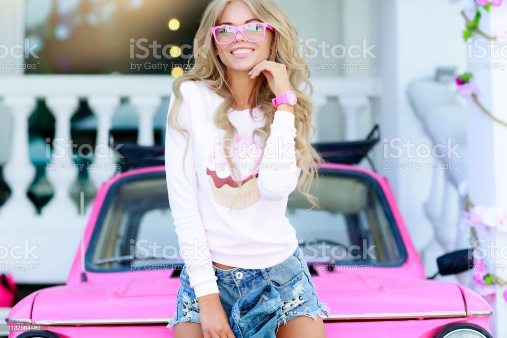 New Stylish Girl With Denim Jacket Near The Pink Car With A