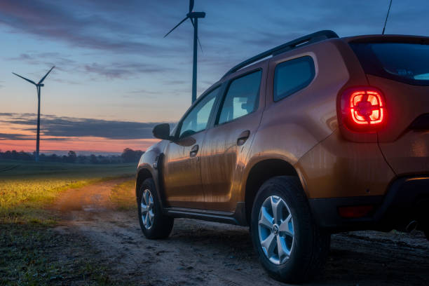 New SUV model Dacia Duster when driving off-road before sunrise