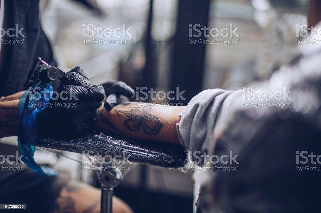 New tattoo on arm stock photo
