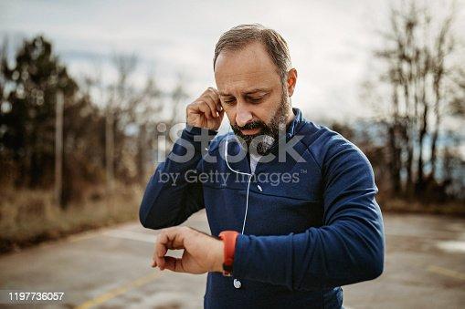 Senior man doing workout on playground
