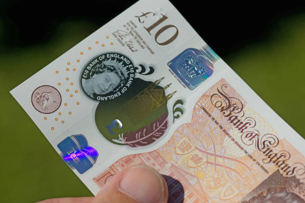 New ten pound note released 2017 Close up of the  new UK ten pound note released into circulation 14 Sep 2017. ten pound note stock pictures, royalty-free photos & images