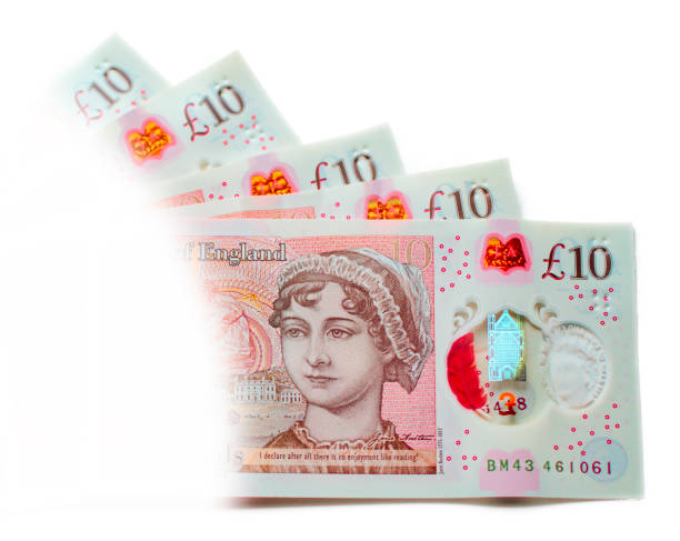 UK new ten pound notes fifty pounds Fifty pounds in the new UK ten pound notes (five notes). Light treatment with vignette. ten pound note stock pictures, royalty-free photos & images