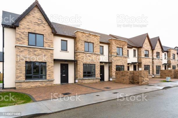 Photo of New terraced houses for sale in a residential development