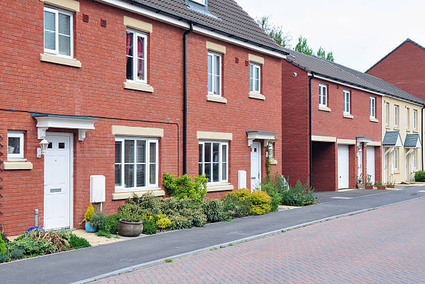 new terraced houses - council flat stock photos and pictures