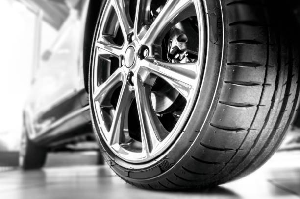 New tire and rim New tire and rim luxury car stock pictures, royalty-free photos & images
