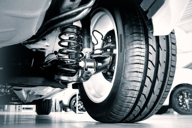 New tire and shock absorbers New tire and shock absorbers vehicle part stock pictures, royalty-free photos & images
