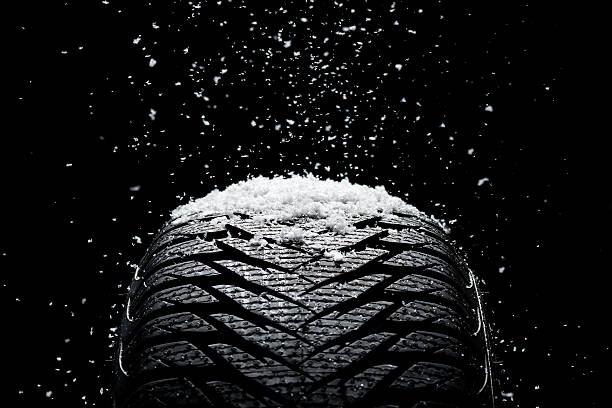 new tire covered with snow - wheel black background bildbanksfoton och bilder