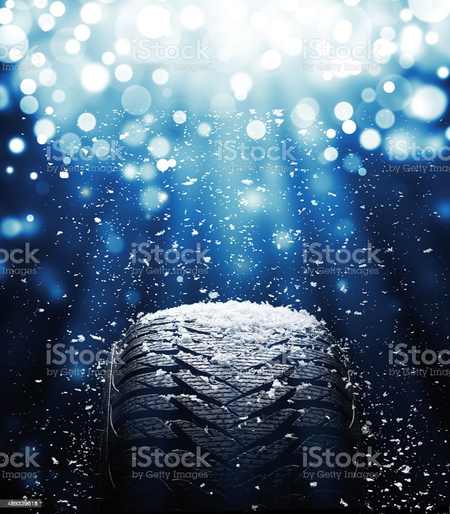 New tire during snowstorm stock photo