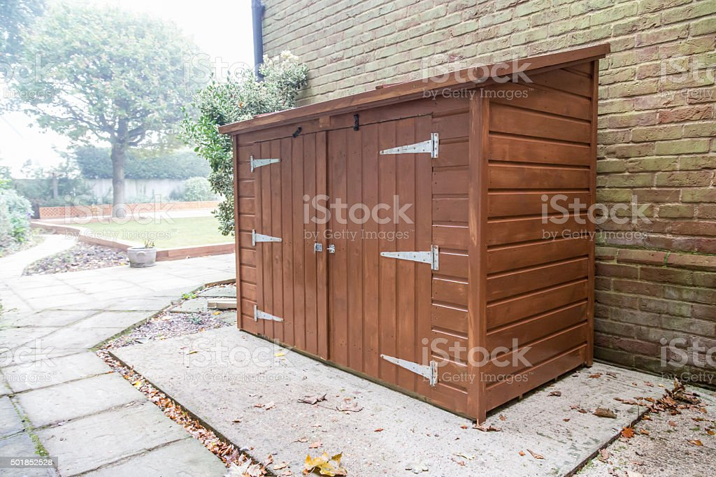 New tool shed in a garden. stock photo