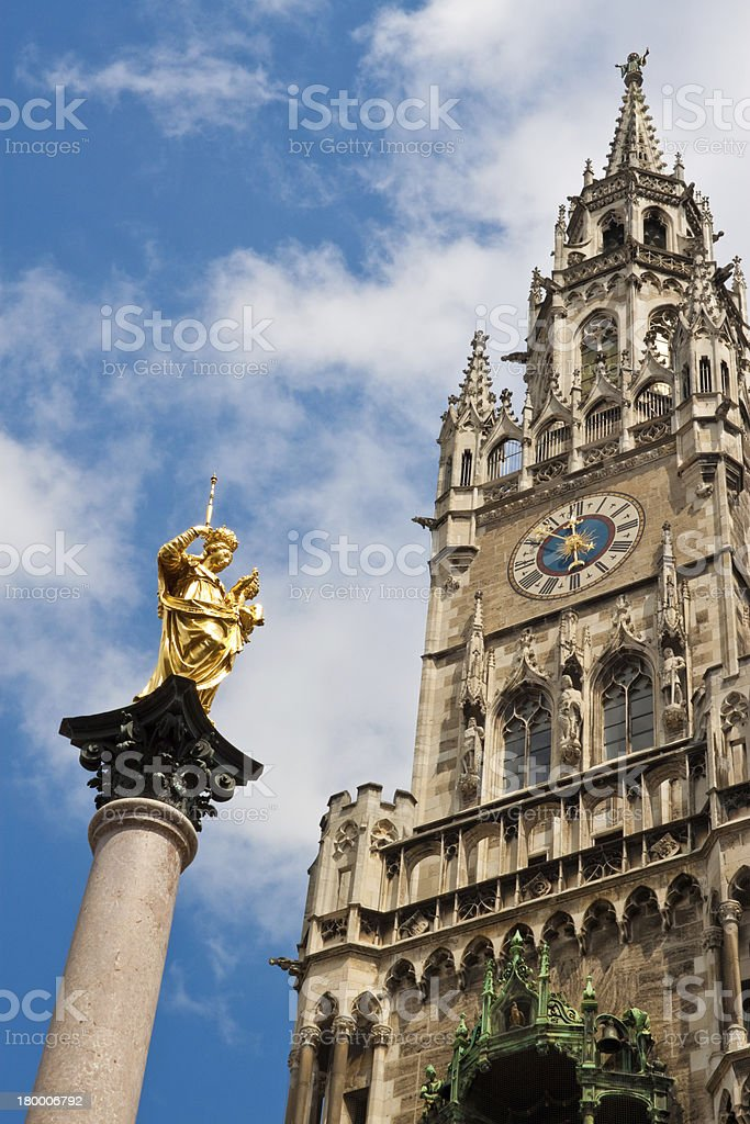 New Townhall and a statue of Virgin Mary in Munich stock photo