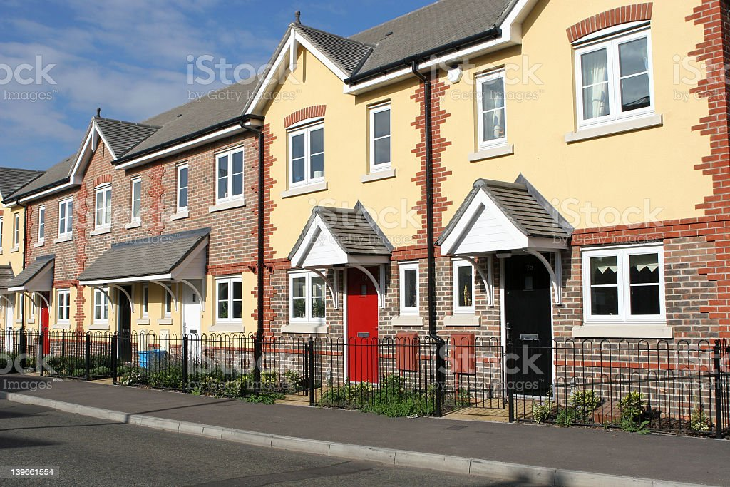 New townhouses on sunny street stock photo