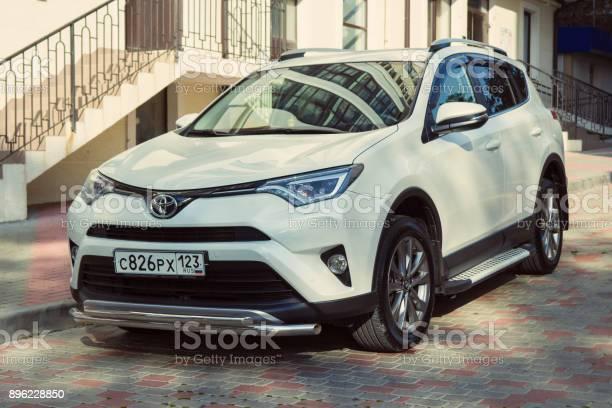 New Toyota RAV4 parked near house.
