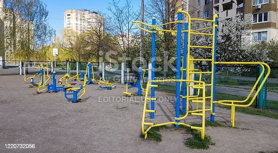 Ukraine, Kiev - April 24, 2020. New training complex in the courtyard of a residential building. Sports ground in the courtyard of a multi-story building. Horizontal bars and bars for athletes on the