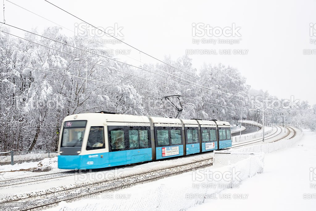 New tram in snowy landscape. stock photo
