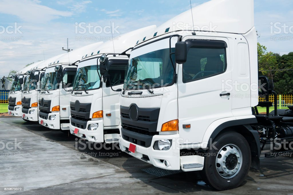 New truck fleet is parking in depot for logistics services. stock photo