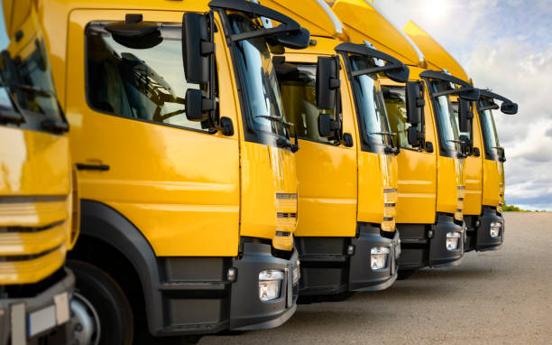New trucks parked in a row stock photo
