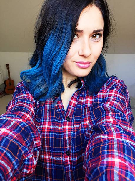 New turquoise hairstyle Selfie of a young girl with a turquoise dyed hair taken on mobile device stock pictures, royalty-free photos & images