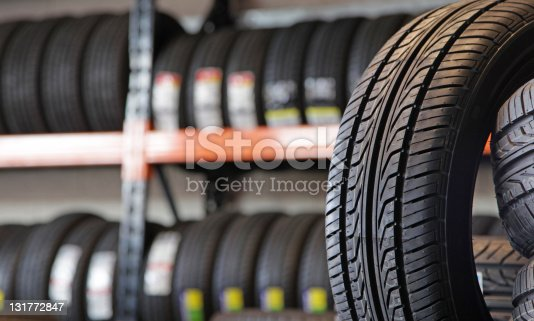 A new tyre in a garage.