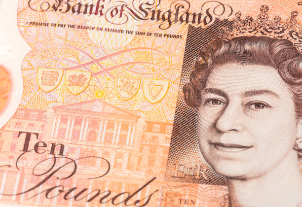New UK ten pound note with portrait of Queen Elizabeth II Edinburgh, UK - Closeup showing a portrait of Queen Elizabeth II on a newly issued polymer British ten pound note. ten pound note stock pictures, royalty-free photos & images