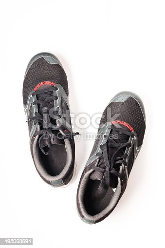 istock New unbranded running shoe color black, sneaker or trainer isolated 495063694